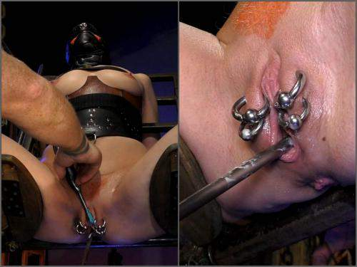 Urethral Sounding – Piercing labia stretching and urethral sounding to bondage girl