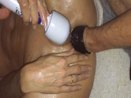 Close Up – Hand with latex glove deep penetrated into asshole
