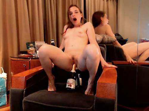 Anal Insertion – Wonderful girl Little Miss rides on a two big champagne bottles