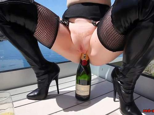 Bottle Penetration – Big tits MILF outdoor rides on a champagne bottle